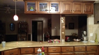 Peninsula, after--shorter cabinets open up the area