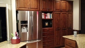 Fridge area, after remodel--love the microwave shelf and the 3 pull out pantry shelves!