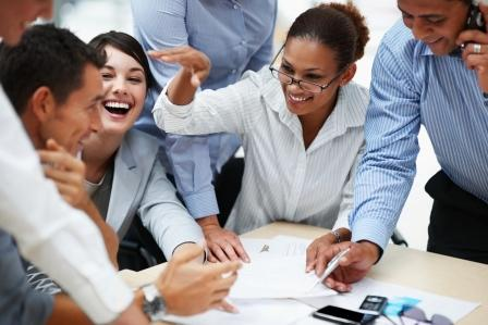 Smiling business people working together at a meeting
