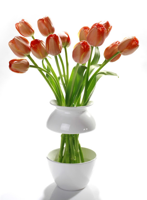 Vases with flowers in them can be a strategic deterrent to clutter #organizingtips