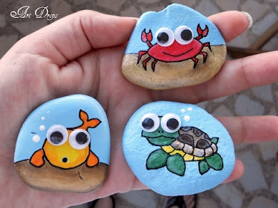 Under the sea creatures painted on stones - crab, fish and turtle