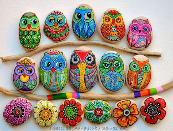 Owl and flower painted rocks on a branch