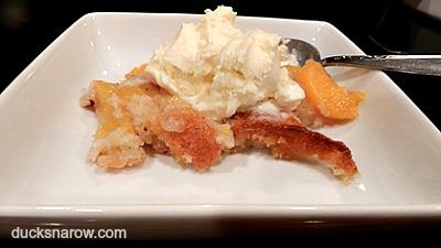 Peach cobbler served with vanilla ice cream
