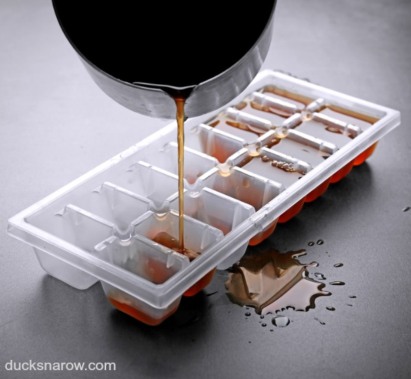 Ice cube trays filled with coffee. Coffee ice cubes cool hot coffee without diluting the taste. #tips