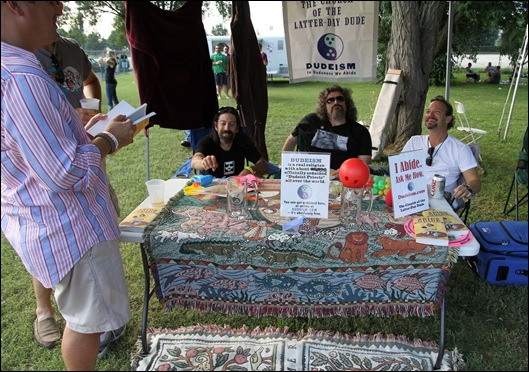 Rev GMS, Rev Paul Niesen and The Dudely Lama at the Dudeism booth