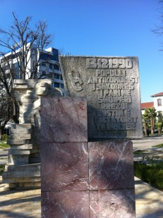 """shkoder. an interesting monument in that it is of the albanian communist era style but it recognizes the people who protested the regime in 1990. """"The anti-communist peopel of Shkoder, the first in Albania, brought down the bust of the hated dictator"""""""