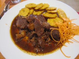 Chivo Guisado with Tostones