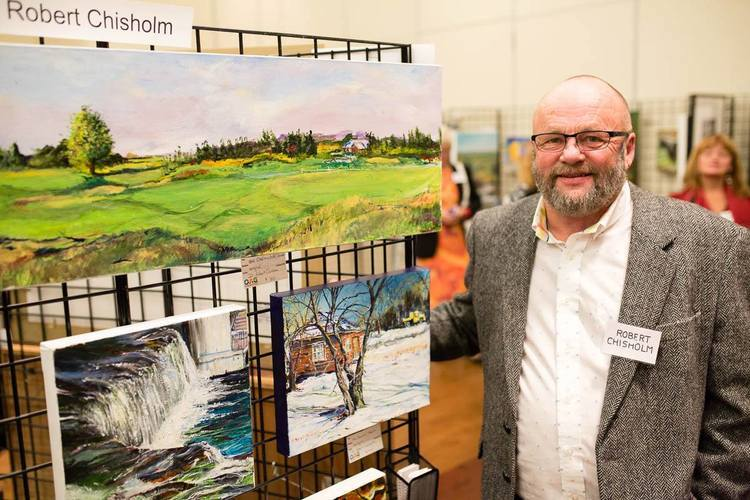 Robert Chisholm with some of his work