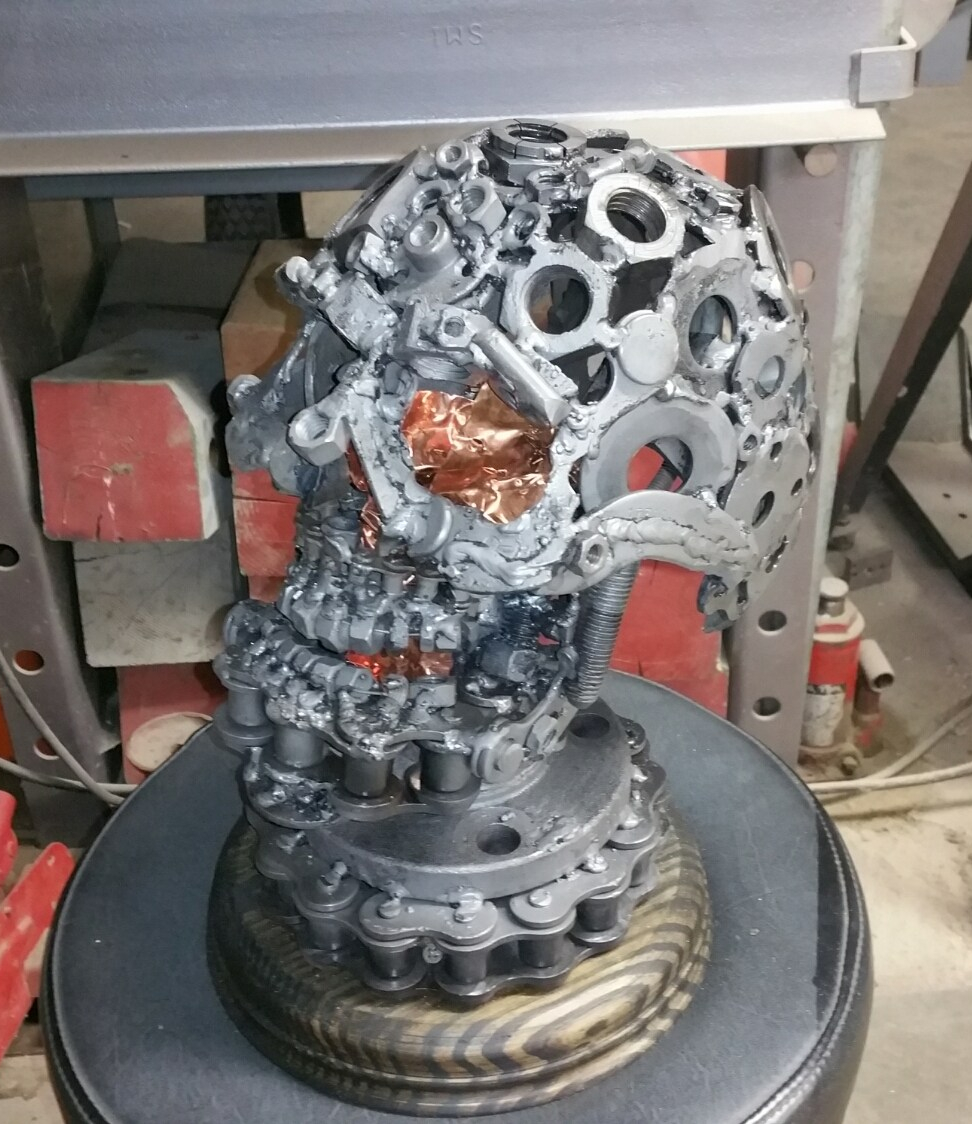 metal skull sculpture facing left