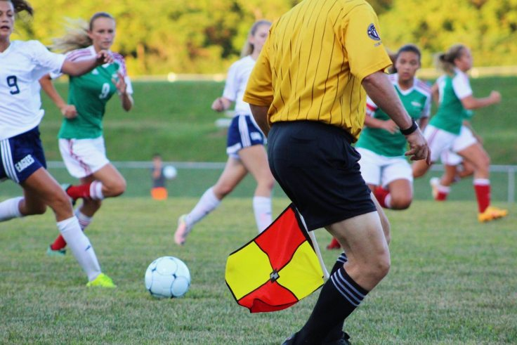 Women playing football (Male linesman)