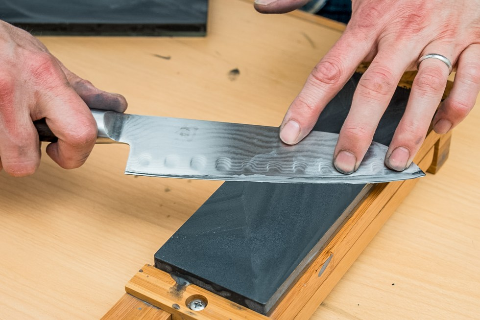 Photo of knife being sharpened