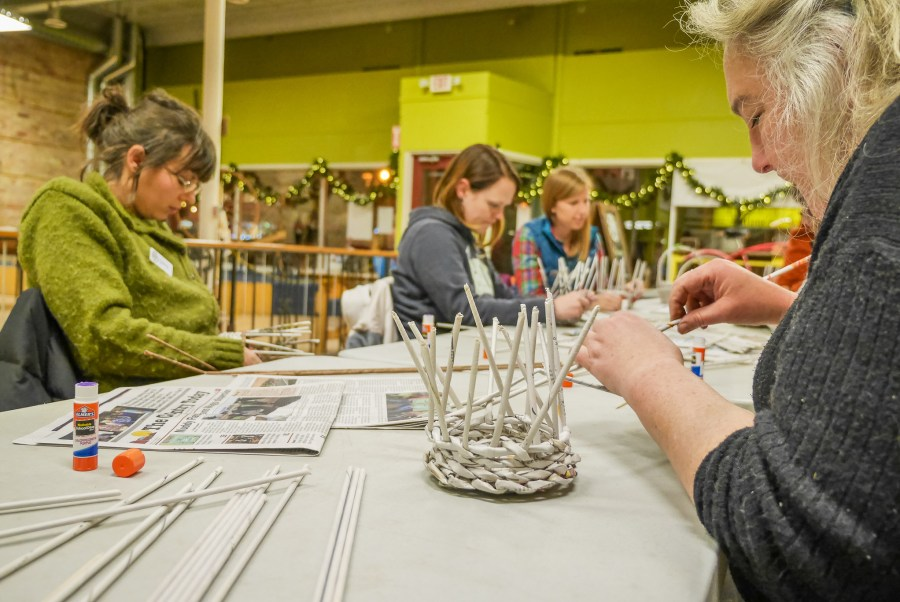 Weaving newspaper baskets at the Duluth Folk School