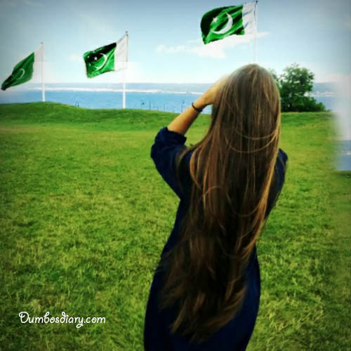 A girl looking at Pakistani Flag