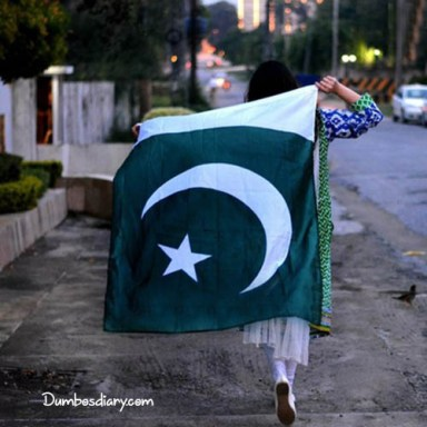A girl running with Pakistani Flag