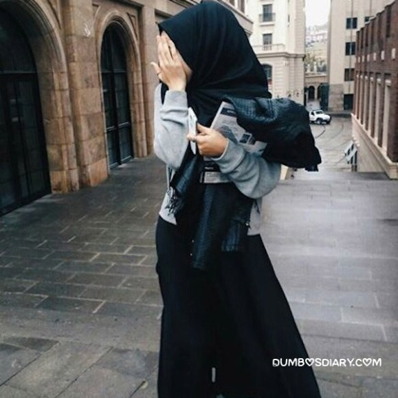 Black dress hijabi girl in street
