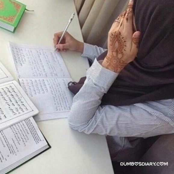 Cute hijabi muslim girl writing