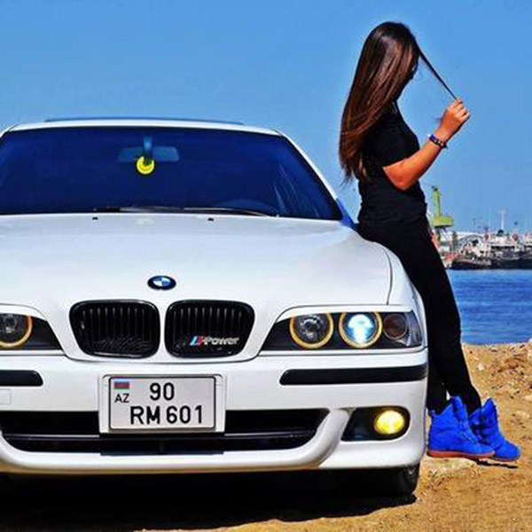 Fashion girl with car on sea site