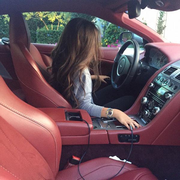 Girl in luxury car