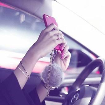 Girl taking selfie in car