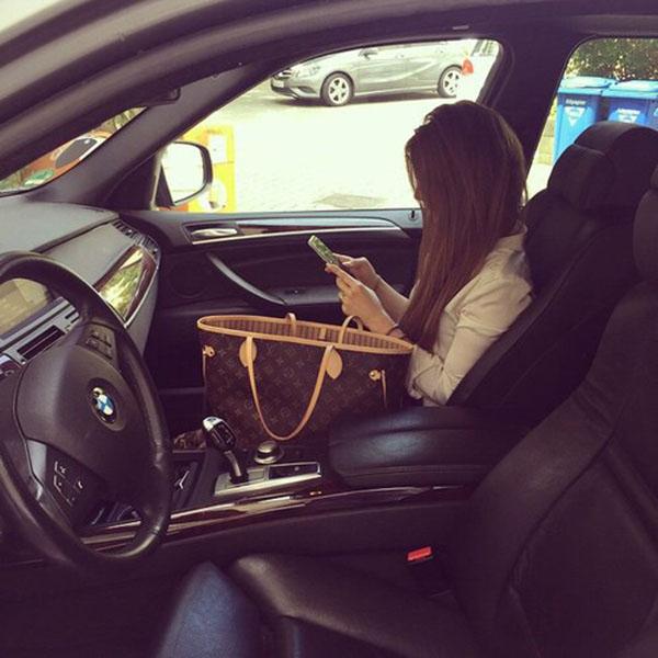Girl using mobile in car
