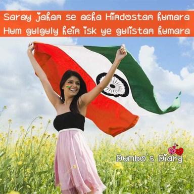 Woman holding an Indian flag in an oilseed rape field