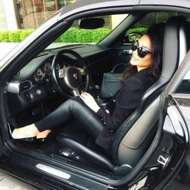 Happy girl in car