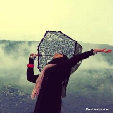 Hijabi girl in rain