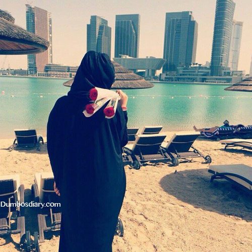 Hijabi girl watching buildings