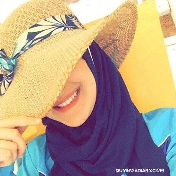 Hijabi girl wearing yellow shade hat