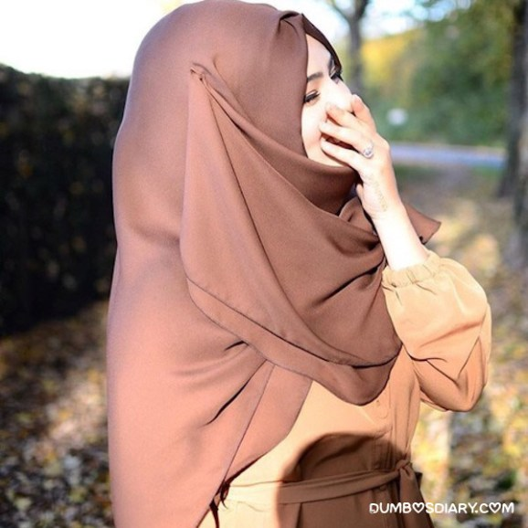 Innocent muslim girl in hijab smiling
