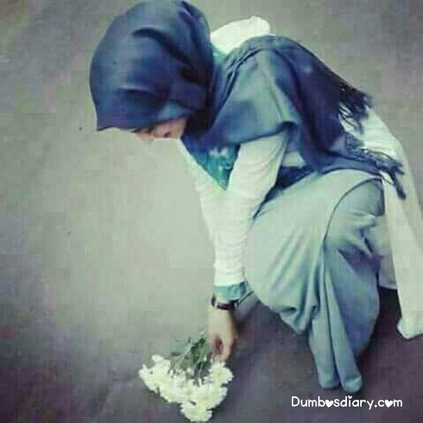 Pretty Hijabi girl with white flowers