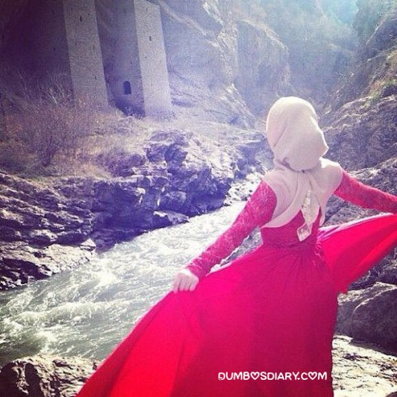 Pretty hijabi girl enjoying weather on hills