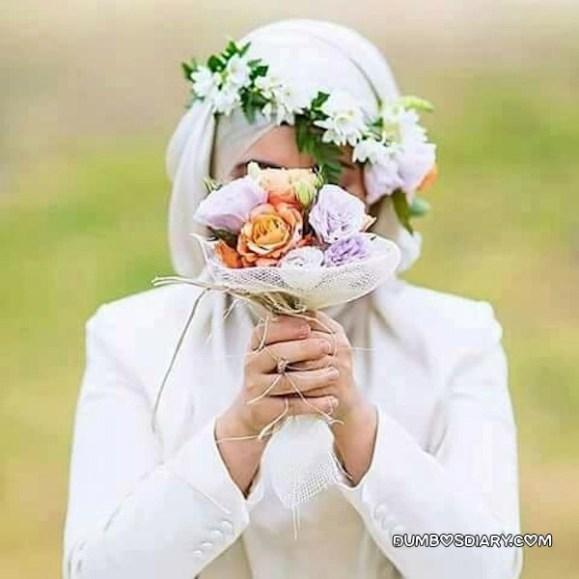 Pretty hijabi girl in white hijab holding roses