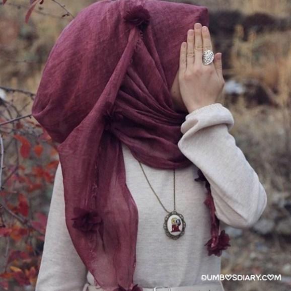 beautiful hijabi girl side pose hidden face