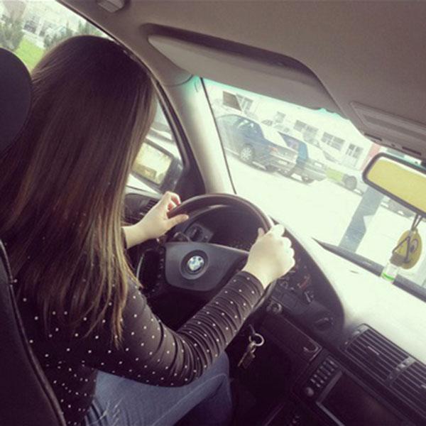 black shirt girl driving