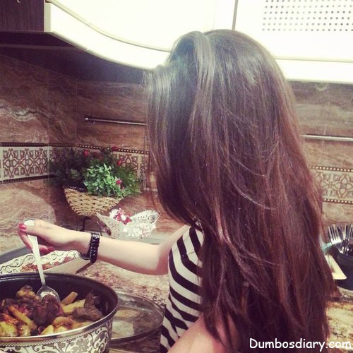girl with open hair cooking
