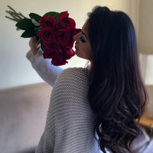 girl-smelling-roses