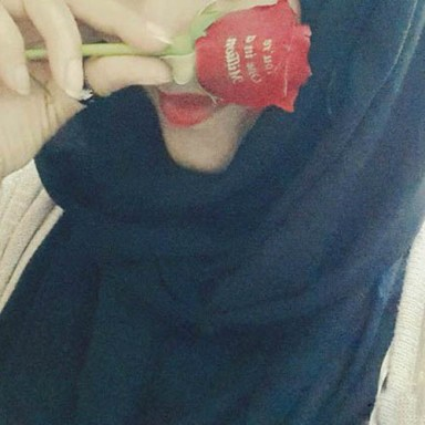 muslim-girl-hiding-her-face-with-rose