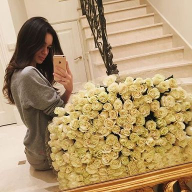 girl-taking-selfie-with-white-roses