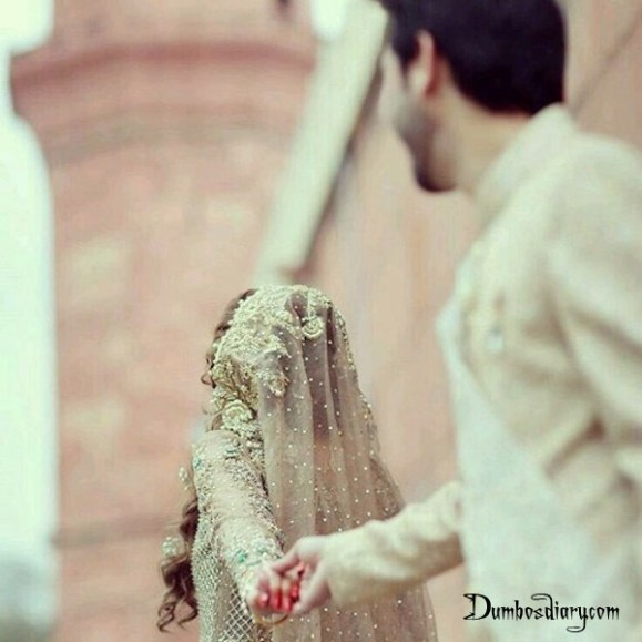 Bride holding hand of groom