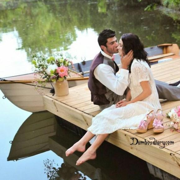 Love couple sitting in boat