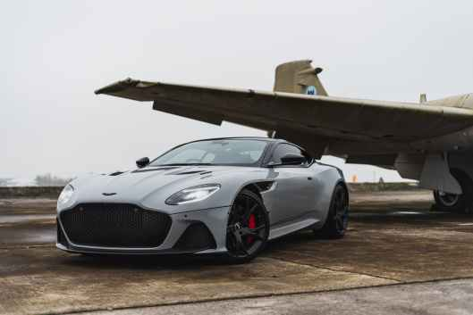 a car parked beside airplane