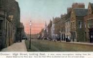 Dunbar High Sreet looking East. A wide roomy thoroughfare leading fro Station Road to the West End. Here the Post Office is situated and all the principal shops - a recoloured image