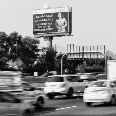 A billboard on the side of a busy road advertising a hospital specialising in digestive health, Dubai, UAE