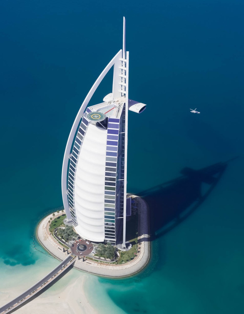 An Aerial photograph of a helicopter landing on the Burj Arab, Dubai by photographer Duncan Chard
