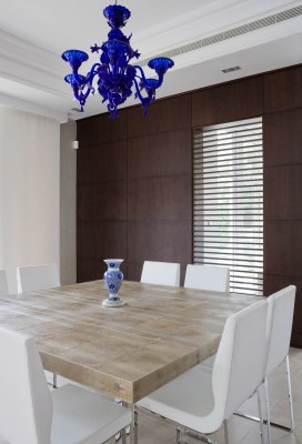 Interior photograph showing the dining room design of an Emirates Hills villa, Dubai.