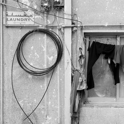 Laundry hanging up to dry on the rear of a laundry shop in Sharjah, UAE