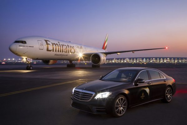 Emirates Airways Boeing 777 and Mercedes S-Class at Dubai Airport