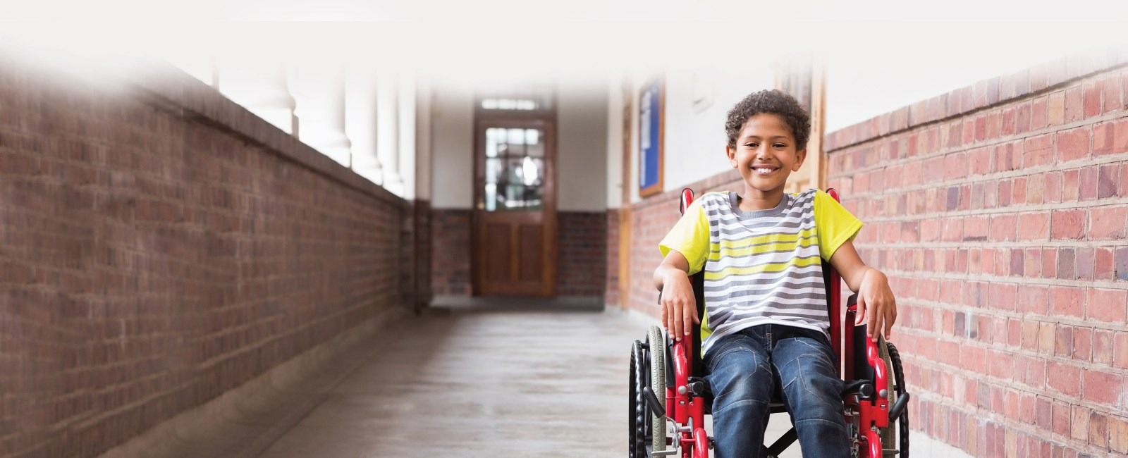 disabled child in hallway