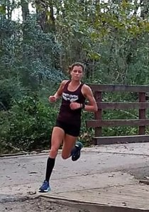 Maggie McCormick wins girls conference cross country championship